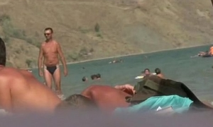 Nudist teen not shy about posing naked in advance beach