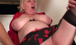 Hellacious granny spreads her legs for two cocks