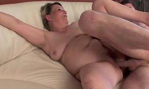 Chesty granny Betty fucks younger hunk