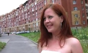 young red-haired bitch sucks on the beach