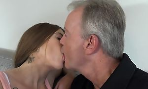 Sex-starved brunette pleasuring dad on the sofa