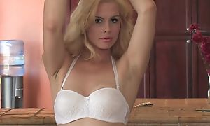 Sex-starved blondie anent natural tits fucks herself in the kitchen