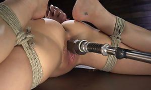 Pitch-dark cougar with big boobs shagged by a screwing machine